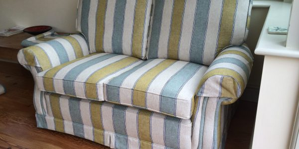Parker Knoll suite covered in a striped Linwood fabric.